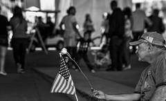 Born Free (Southern Darlin') Tags: street streetphotography photography photo people bw blackandwhite depth bokeh flower rose flag man louisville kentucky festival festaville life black white mono world