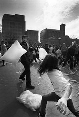Duel (Brian Gilbreath) Tags: ifttt 500px man woman group street two recreation crowd performance administration outfit leader dress black white bw film photography streets streetphotography 35mm people portrait urban monochrome pillow fight new york city duel battle documentary