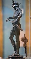 Alfred Gilbert (1854-1934) - Perseus Arming (1881-3), left, Ashmolean Museum, Oxford, August 2016 (ketrin1407) Tags: alfredgilbert perseus bronze statue statuette sculpture nude naked sensual erotic sword helmet wingedhelmet sandals wingedsandals mythology ashmoleanmuseum oxford