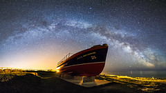 Sailing Beneath The Stars [EXPLORED] (Graham Daly Photography (ASINWP)) Tags: ballycotton canon6d grahamdalyphotography ireland landscapephotography longexposure seascapes astro astronomyireland astrophotography ballycottonlighthouse hahnelcapturremotes imagesofireland landscapesofireland milkyway nightphotography nightshoot nightsky outdoors reallyrightstuff rolleitripod samyang14mm space stars panorama panoramic stitchedpanoramic stitchedpano rnlbmarystanford lifeboat