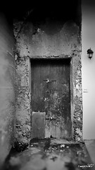 old doors (Massimo Vitellino) Tags: olddoors abstract contrast conceptual hdr blackandwhite structure house lights shadows perspective noperson city