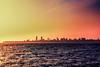 Bombay Dreams (iratebadger) Tags: nikon nikond7100 d7100 skyline city cityscape india mumbai sky shadows silhouette buildings sea indianocean waves lightroom light dark colaba peach pink moody atmospheric outside urban iratebadger orange yellow