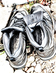 Walk A Mile In My Shoes (Steve Taylor (Photography)) Tags: walkamileinmyshoes trainers laces abandoned left digitalart muted gravel newzealand nz southisland canterbury christchurch cbd city grass texture