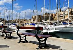 Grand Harbor (Colorado Sands on break) Tags: malta island mediterranean sandraleidholdt hbm bench yacht sailboat boats marina harbor republicofmalta nautical birgu vittoriosa southerneurope grandharbour harbour mast boat water