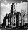 Wise County Courthouse in B&W (PEN-F_Fan) Tags: olympuspenf northamerica nationalregisterofhistoricplaces on1photoraw photoborder on1photoraw2018 monotone mft m43 mzuiko12100mmf40pro monochrome mirrorless microfourthirds texas unitedstatesofamerica wisecountycourthouse wisecounty postprocessing photoframe photoedge preset raw processingsoftware blackwhite building automagic affinityphoto architect architecture filmlook jamesrielygordon courthouse dxophotolab dxoviewpoint decatur usa tower sky