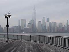 Towers of Manhattan (CVerwaal) Tags: architecture batteryparkcity hudsonriver waterfront newyork ny usa olympusem5 lumixgvario1235mmf28