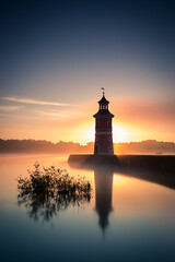 glowing sunrise (mad_airbrush) Tags: 5d 5dmarkiii saxony sachsen germany deutschland moritzburg lighthouse leuchtturm sunrise sonnenaufgang morning morgen fog foggy nebel glow 2470mm ef2470mmf28l longexposure langzeitbelichtung nd ndfilter formatthitech