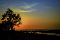 Besame....!!! (Nita_Fotos) Tags: sun sundown clouds blue orange sol atardecer nubes naranja cielo mountain montañas reflection reflejos trees arboles agua backligh contraluz lecheria venezuela tuniñasalvajedelaselva