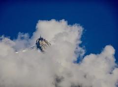 Aiguille du Midi surrounded by clouds. (elsa11) Tags: aiguilledumidi chamonix hautesavoie rhonealps alps alpes alpen france frankrijk mountains montagnes clouds sky lucht wolken