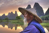 The li river legend (Gregory Michiels Photography) Tags: cormorant fishermen yangshuo xingping sunset reflection travel explore discover guangxi karst mountains hills china portrait guide tour ebook bamboo hat