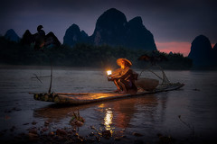 Fisherman (Massetti Fabrizio) Tags: guilin guangxi green guanxi giallo xingping yangshou yangshuo yellow rural red river rosso landscape landscapes portait nikond4s 2470f28 light china color cina