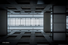 Futile (Tim-Dallos) Tags: d750 architecture monochrome leeds armouries building brutal cold museum symmetry geometry perspective depth look up