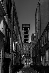 Old and new (Niaic) Tags: urban street city night nighttime dark tower towering building buildings blackandwhite monochrome architecture