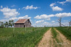 Barn in Kansas. (Chris Eiel) Tags: kansas barn grass barbed wire clouds highway148