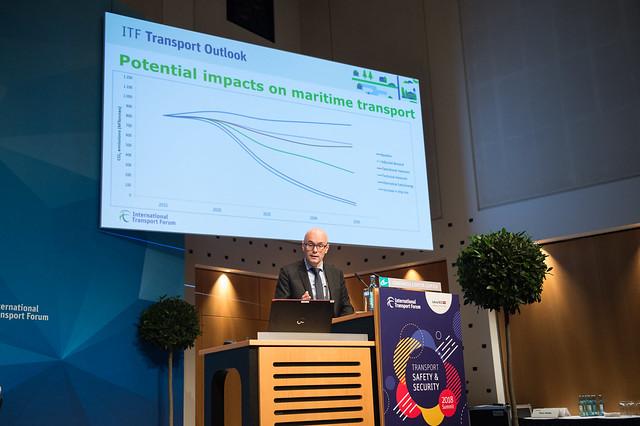 Jari Kauppila presenting on the potential impacts on maritime transport
