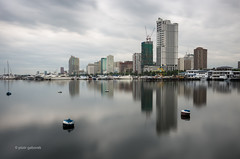 Manila Bay (pietkagab) Tags: manila bay philippines luzon island city capital building buildings reflections water sea sky cloudy clouds longexposure southeast asia asian 10stop nd le architecture tall skyscrapers pietkagab photography pentax pentaxk5ii piotrgaborek travel trip tourism sightseeing morning adventure