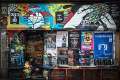 Malasaña, Madrid (Adrià Páez) Tags: malasaña madrid city capital maravillas universidad man sleeping posters streetart homeless graffiti spain españa europe canon eos 7d mark ii