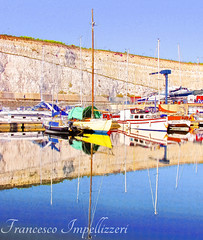 The Shapes on Water (Francesco Impellizzeri) Tags: brighton england marina boats water reflections canon landscape