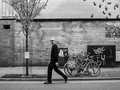 Northern Quarter 233 (Peter.Bartlett) Tags: manchester eyecontact art unitedkingdom people walking city graffiti bike wall streetphotography olympuspenf tree peterbartlett man urban niksilverefex candid uk m43 microfourthirds cycle bw noiretblanc sign blackandwhite monochrome facade england gb