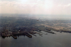 The old smoggy post industrial version of Jersey City with abandoned factories, railroads and piers. Exchange Place and Harborside Terminal at left. Taken from my dad's office in the World Trade Center North Tower. Sept 1975 (wavz13) Tags: oldphotographs oldphotos 1970sphotographs 1970sphotos oldphotography 1970sphotography vintagephotographs vintagephotos vintagephotography filmphotos filmphotography oldworldtradecenter vintageworldtradecenter twintowers originalworldtradecenter oldbuildings abandonedbuildings industrial industrialphotos industrialphotography oldfactories vintagefactories jerseycityphotographs jerseycityphotos oldjerseycityphotography oldjerseycityphotos oldjerseycity vintagejerseycity vintagejerseycityphotography jerseycityhistory urbanphotography urbanphotos urbanscenes cityphotography cityphotos newjerseyphotographs newjerseyphotos oldnewjersey vintagenewjersey newjerseyhistory 110film kodacolor analogphotography instamatic pocketinstamatic industrialruins factoryruins industrialwasteland urbanwasteland industrialjerseycity abandonedrails abandonedrailroads abandonedtracks urbandecay urbanblight hudsonriver dreary polluted pollution goodyearblimp zeppelin meadowlands swamps