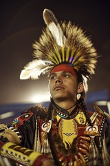 Being proud of one's heritage (PeterThoeny) Tags: stanford stanforduniversity california siliconvalley sanfranciscobay sanfranciscobayarea southbay powwow stanfordpowwow festival competition dance costume americanindian portrait person boy feather light backlight night sony a7 a7ii a7mii alpha7mii ilce7m2 fullframe vintagelens dreamlens canon50mmf095 canon 1xp raw photomatix hdr qualityhdr qualityhdrphotography fav100