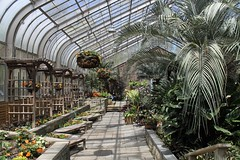 Brookside Gardens ~ Conservatory (karma (Karen)) Tags: wheaton maryland brooksidegardens parks gardens conservatory plants flowers palms benches arches trellis windows walls shadows hww