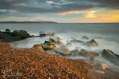 Early evening light - Milford on Sea (Explored) (C Sinclair) Tags: milfordonsea isleofwight seascape longexposure shore rocks tide beach