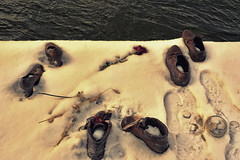 Shoes on the Danube Bank (tcees) Tags: idantalljózsefrkp budapest hungary pest danuberiver cantogay gyulapauer memorial urban shoes iron sculpture nikon d5200 1855mm winter cold freeze freezing water flower candle snow snowing footprints holocaust glass jar