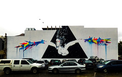 Arise Again Christchurch (Steve Taylor (Photography)) Tags: vexta wings carpark bird art abstract graffiti mural streetart rainbow newzealand nz southisland canterbury christchurch cbd city cloud car woman lady hair stars runs triangle