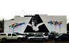Arise Again Christchurch (Steve Taylor (Photography)) Tags: vexta wings carpark bird art abstract graffiti mural streetart rainbow newzealand nz southisland canterbury christchurch cbd city cloud car woman lady hair stars runs triangle