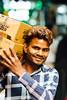 Man Carrying Boxes, New Delhi India (AdamCohn) Tags: adamcohn delhi india newdelhi bokeh carry man smile streetphotographer streetphotography wwwadamcohncom