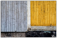Untitled 00.78 (ViTaRu) Tags: olympus omd em10 mzuiko m43 microfourthirds 1442mm wall building boards colors contrast gray yellow wooden concrete symmetry pattern texture house old vanharauma satakunta finland