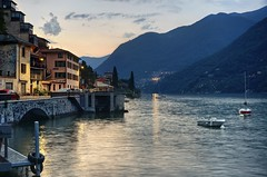 A magic moment at Lake Como (PeterThoeny) Tags: laglio italy house architecture town village lake boat mountain dusk evening sunset outdoor sony nex6 selp1650 3xp raw photomatix hdr qualityhdr qualityhdrphotography ristoranteosteriavecchiomolo water sky building mountainside fav200