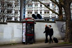 Kings Cross 4/8 (Harry Goddard) Tags: photography nikon d3200 1855mm urban street phone couple walking walls windows frames graffiti tower block white colour trees saturation vibrant london united kingdom
