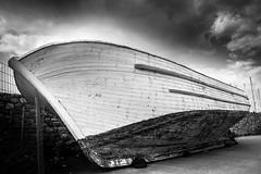 rest (Nick Frantzeskakis) Tags: wooden abandoned art rest artistic boat massinia kalamata peloponnese greece port bw