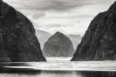 Haystack Rock (Joshua Johnston Photography) Tags: joshuajohnston sonya7ii oregon pacificnorthwest pnw landscapephotography nature bnw blackandwhite sonyfe70300mmf4556goss oregoncoast cannonbeach haystackrock