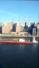 barge traffic from 8th floor (wmpe2000) Tags: 2018 nyc spring icu view eastriver barge boat tugboat rooseveltisland powerplant smokestacks redwhite