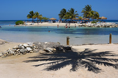 Time To Cool Off,Mon! (Poocher7) Tags: shadow palmtrees water ocean sand beach island jamaica westindies caribbean swimming wading coolingoff keepcool rocks rope poles bluesky sunny hot montegobay mobay sundaylights beautiful lovely