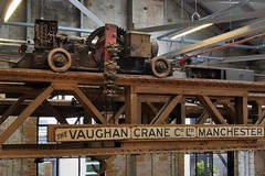 Overhead travelling electrics - The Vaughan Crane Co. Ltd., Manchester, c1900 - Docklands, London (edk7) Tags: olympusomdem5 edk7 2018 uk england london londone14 londonboroughoftowerhamlets isleofdogs docklands millwall theforge millwallironworks cjmareco 1860 architecture building oldstructure city cityscape urban heritage gradeiilisted victorian westferryroad window arch overheadelectrictravellingcranethevaughancranecoltdmanchesterc1900 historic relic rust sign signage rail wheel lattice girder rheostat terminal insulator chassis gear hook