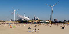 On the beach (Marco van Beek) Tags: beach people sun blue sky windmill industirial sea water holland europe beautiful world nikon d5000 afs dx nikkor 18200mm f3556g ed vr ii