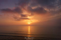 When the day is done (Mimadeo) Tags: sunset sunrise sea water orange seascape sun red landscape sundown nature ocean dusk color evening background horizon beautiful sunlight light dawn scenic scenery golden beauty tranquil calm relaxation idyllic peaceful sky empty nobody closeup waves