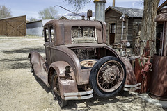 Old Ford Model A Coupe at an old gas station (Alan Vernon.) Tags: california canoneos1dxmkii copyrightalanvernon2018 abandoned automobile car historic old relic rusty ford model a coupe gas station rusting decay decaying yesteryear