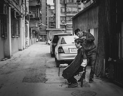 Xian' Barbershop (Ash and Debris) Tags: urbanlife blackandwhite asia street people city clipping china streetlife yard bw urban barber citylife monochrome bnw barbershop master xian blacknwhite asians