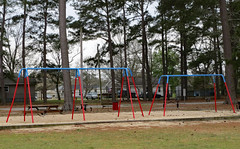 Swing Sets. (dccradio) Tags: lumberton nc northcarolina robesoncounty lutherbrittpark park citypark outdoors outside spring springtime tree trees greenery foliage yard grass lawn sand playground swings swingset canon powershot elph 520hs