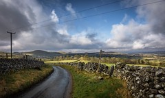 Round the bend (Phil-Gregory) Tags: hartington milldale peakdistrict nikon d7200 tokina tokina1120mmatx cloudscape clouds sign road countryside countrylife derbyshire green wideangle ultrawide national naturalphotography naturephotographyna naturephotography naturalphotograph scenicsnotjustlandscapes landscapes