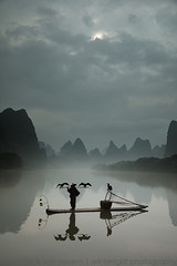Cormorant Fisherman (winterlight photography) Tags: asia asian asie azië china guangxiprovince guilin liriver yangshuo landscape fishing fisherman cormorant tradition mist fog boat bamboo raft
