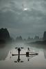 Cormorant Fisherman (winterlight photography) Tags: asia asian asie azië china guangxiprovince guilin liriver yangshuo landscape fishing fisherman cormorant tradition mist fog boat bamboo raft
