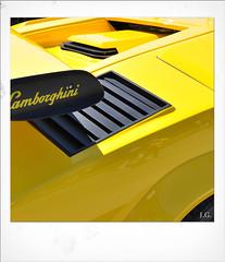 Jus_Polaroids11 (reinhard_srb) Tags: artwork polaroid automarke automobil oldtimer ausstellung logo farbe fahrzeug historisch detail karosserie blech lack design spiegelung glanz sammler lamborghini heckflügel kühlschlitze gelb