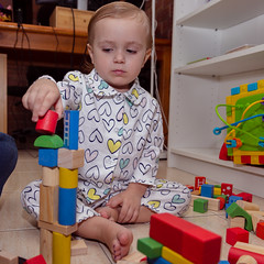 Consruxshns hard (obLiterated) Tags: charli home blocks wooden colours serious toddler