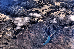 Glacial Lake in the Alps (Stuck in Customs) Tags: lake mountains alps cold clouds plane airplane landscape switzerland air glacier icy hdr glacial glaciallake